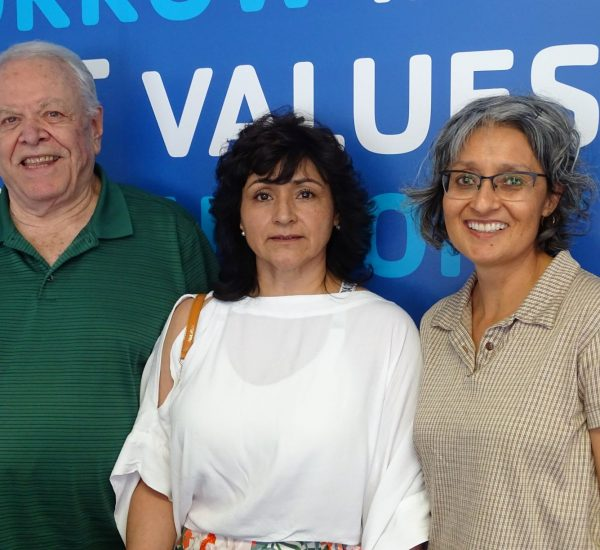 two women and a man standing next to each other